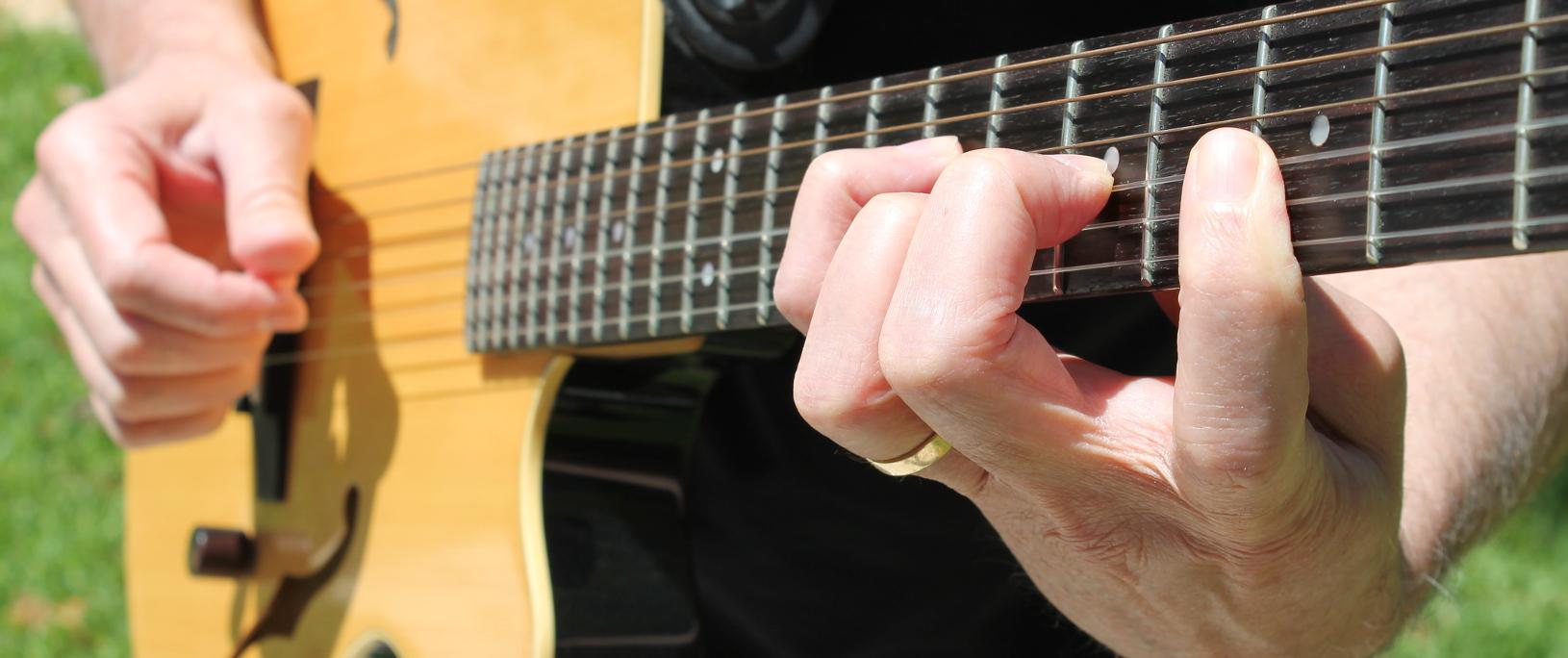 Guitarist Stuart Redd, Contemporary Jazz musician playing Yamaha nylon string guitar